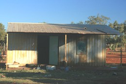 Tin sheds make do for housing in the Aboriginal community of Ampilatwatja. Not one new house has been built under the Intervention