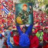 TOPSHOTS Venezuela's acting President Nicolas Maduro holds a picture of the late president Hugo Chavez during a campaign rally in Catia la mar, state of Vargas on April 9, 2013. Venezuelans will elect new president next April 14 and the final stretch of Venezuela's race to replace Hugo Chavez coincides with a delicate anniversary for the opposition: 11 years since a brief coup against the late leftist leader. AFP  PHOTO/Luis Acosta