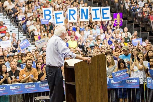 KENNER, LA - JULY 26:  Democratic presidential candidate Senator Bernie Sanders (I-VT) (C) speaks to guests at the Louisiana Rally with Bernie Sanders at Ponchartain Center on July 26, 2015 in Kenner, Louisiana.  (Photo by Josh Brasted/Getty Images)