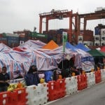 Mass strike fights low pay and long hours on Hong Kong docks